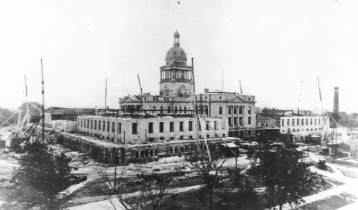 The north and south wings of Goodhue's Nebraska State Capitol embracing the existing capitol building, circa 1924